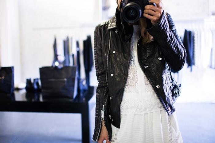 White feminine dress and black leather jacket via The Fashion Toast