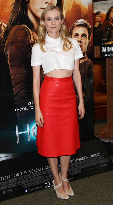 Diane Kruger in crop top and leather skirt via TheHandbag.com