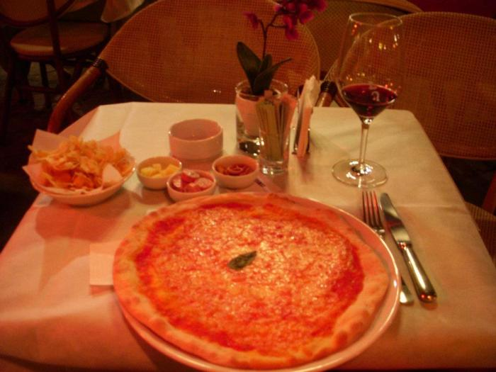 Large Margherita and red wine for one at Piazza Erbe