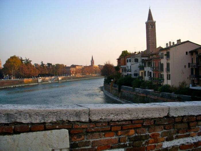 Old brick bridge over Adige River