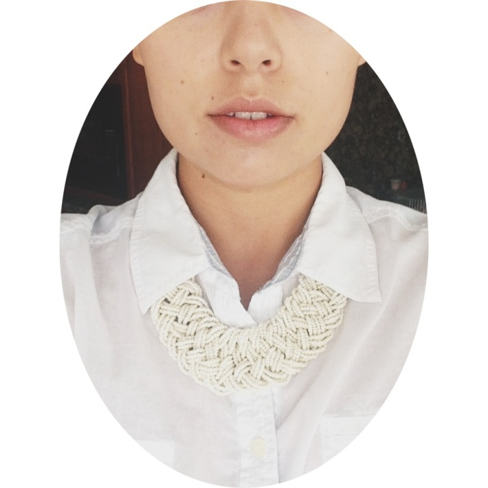 Jazz up your shirt collar with a bulky necklace