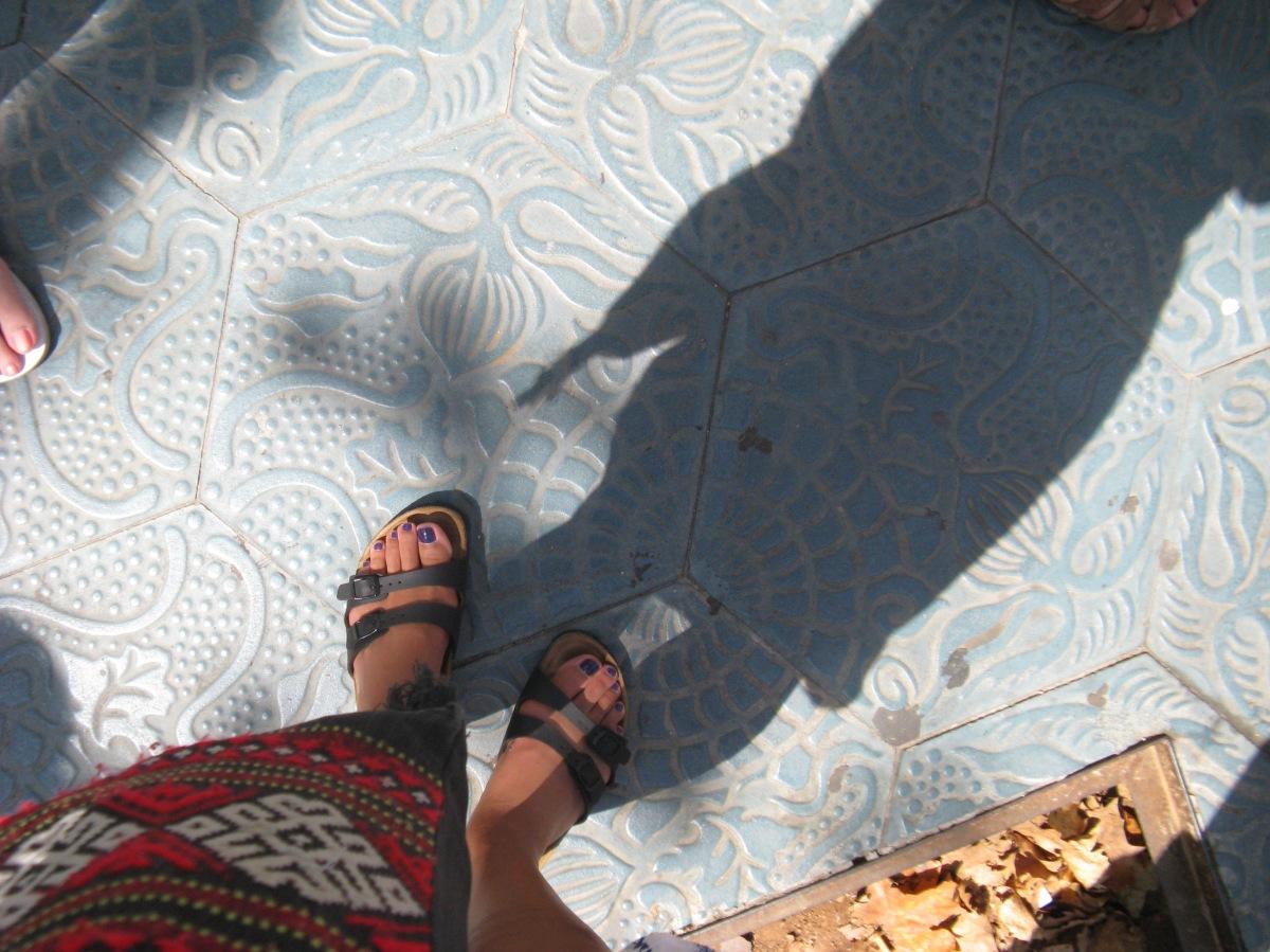Me and my Birkenstock sandals over Gaudi tile in Barcelona