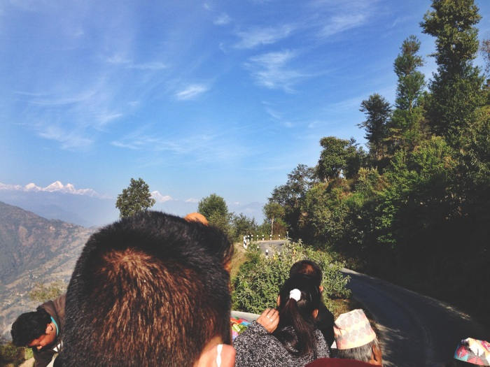 RIding on top of a bus in Nepal
